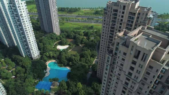 Thumbnail for Aerial Drone Shot Over Residential Apartment Buildings on Sunny Day. Aerial Shot Over Community