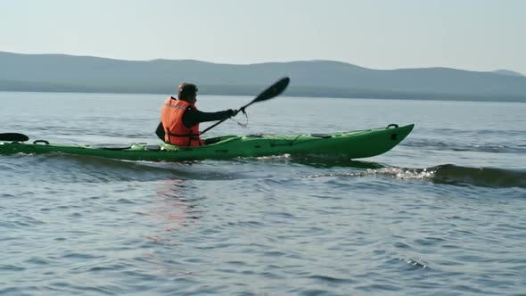 Thumbnail for Kayaking Man on Waving Lake