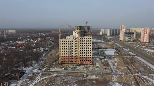 Thumbnail for Construction of a Large Apartment Building. Tower Cranes and Builders Build a Brick House View From