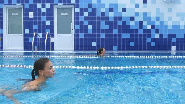 Thumbnail for Young Women Swimming in the Pool