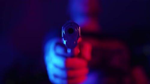 Criminal Holding A Gun
