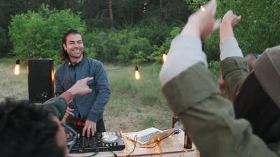 Sequence Of Friends Having Outdoor Party With DJ