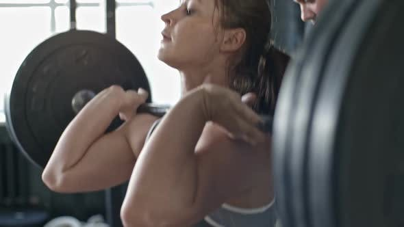 Thumbnail for Coach Helping Woman During Barbell Workout
