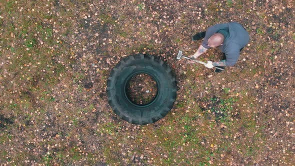 Thumbnail for Tough Tattooed Man Hitting the Truck Tire with a Hammer - Training in the Autumn Forest