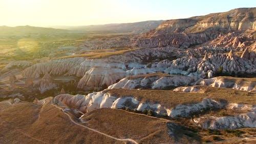 }Hoodoos, Fairy Chimneys an Sedimentary Volcanic Rock Formations in Sunset