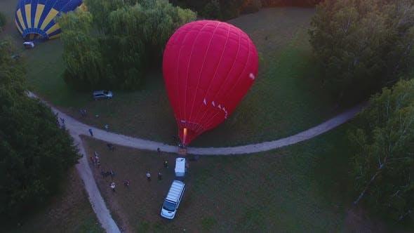Contestants Lifting Air Balloon, Gondola Standing on Ground, Flight Readiness