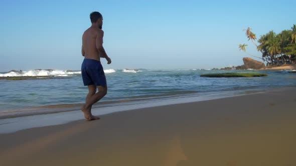 Thumbnail for Professional Athlete Runs Along Sandy Beach in Summer