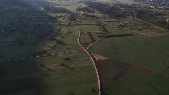 Flying over the countryside on an early spring morning