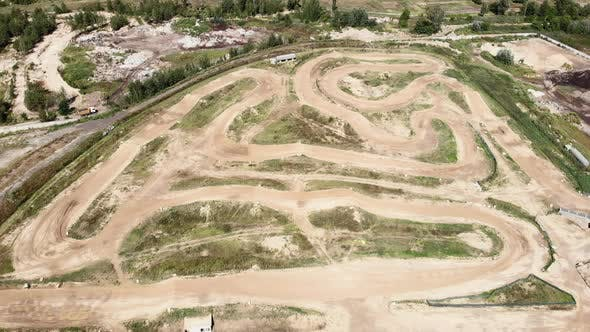 Motorcycle motocross track, ride off-road and jump over sand hills track, aerial drone view