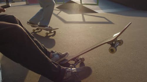 Unrecognizable Teenagers in Skatepark