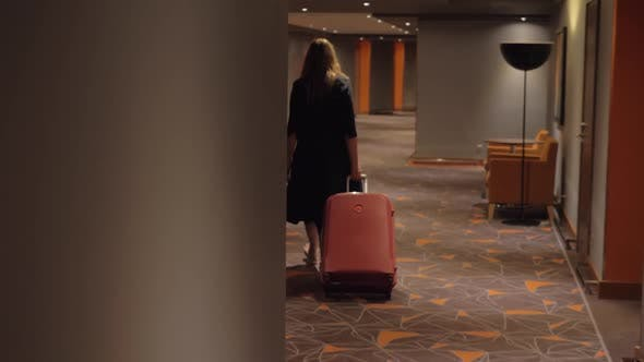 Thumbnail for - Woman with Suitcase Walking To the Room in Hotel Corridor