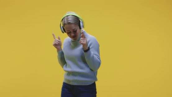 Thumbnail for Woman Dancing with Headphones