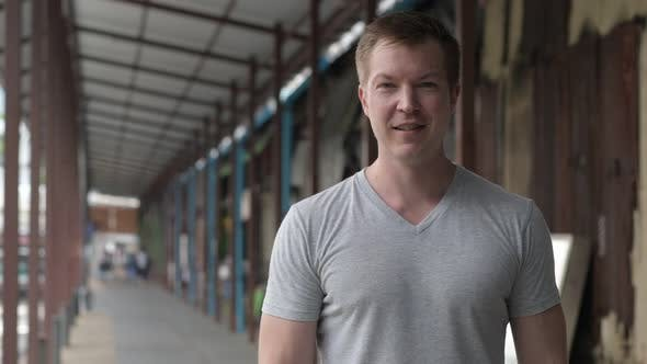 Thumbnail for Young Happy Tourist Man Smiling at the Local Pier in Bangkok
