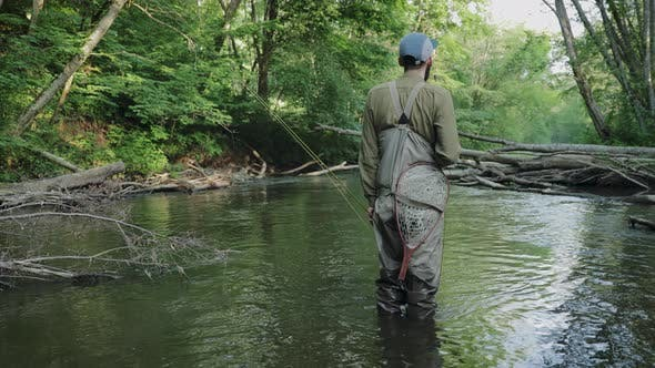 Cover Image for Portrait Of Fisherman Standing In River