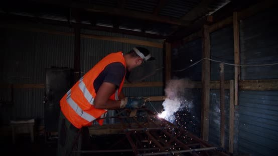 Thumbnail for Slow Motion. Welder Welding The Worker Performs Metal Welding at the Factory or Construction Site