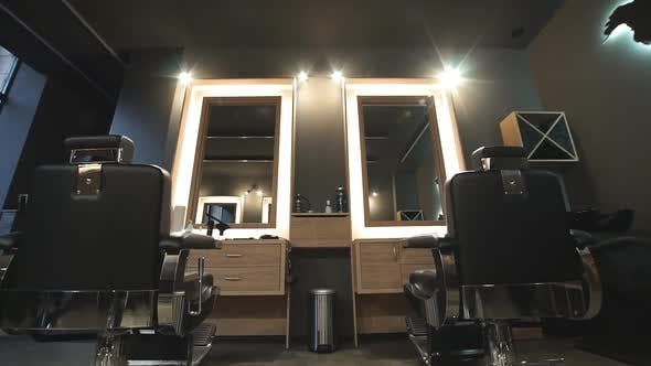Thumbnail for Camera Moving Through Empty Hall in Barbershop. View on Modern Interior of Trendy Hairdressing Salon