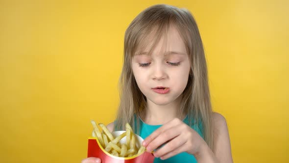 Thumbnail for Hungry Little Girl Eating Fries
