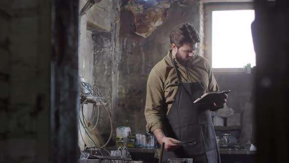 Thumbnail for Blacksmith Using Tablet