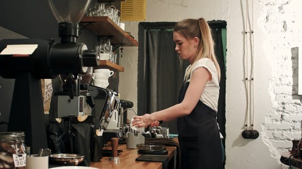 Thumbnail for Barista making coffee with proffessional brewing coffee bar