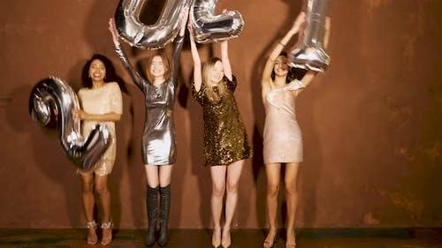 Beautiful Women Celebrating New Year.Happy Gorgeous Female In Stylish Sexy Party Dresses