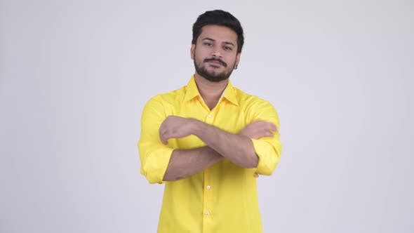 Thumbnail for Young Happy Bearded Indian Businessman with Arms Crossed