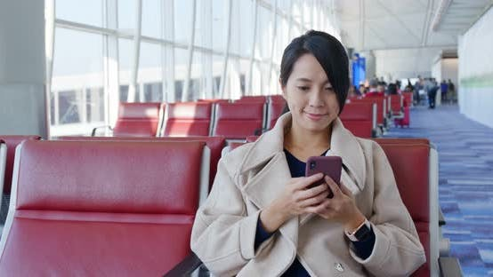 Thumbnail for Businesswoman check on the cellphone and wait for the flight in the airport