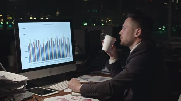 Thumbnail for Businessman Analyzing Data in Dark Office