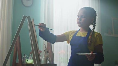 Beautiful Girl Kid Is Painting