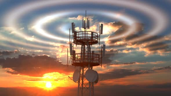 Thumbnail for Cellular Telecommunications Tower with Radio Waves Visible Against Sunset Sky