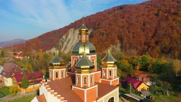 Thumbnail for Aerial Drone Video of Orthodox Church with Gilded Domes in Yaremche in Carpathians Mountains