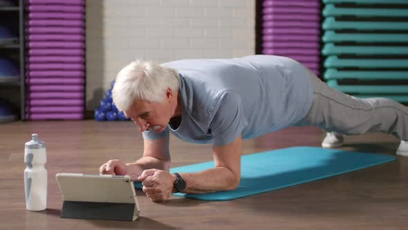 Thumbnail for Senior Following Online Fitness Instructions