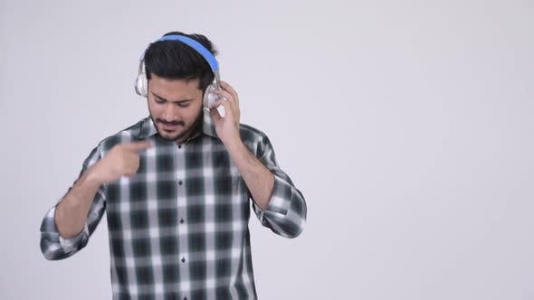 Cover Image for Portrait of Young Happy Bearded Indian Man Listening To Music
