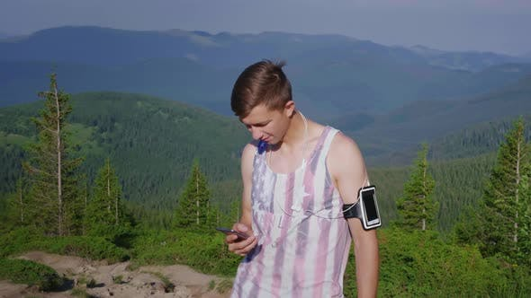Thumbnail for Young Male Athlete Using Phone