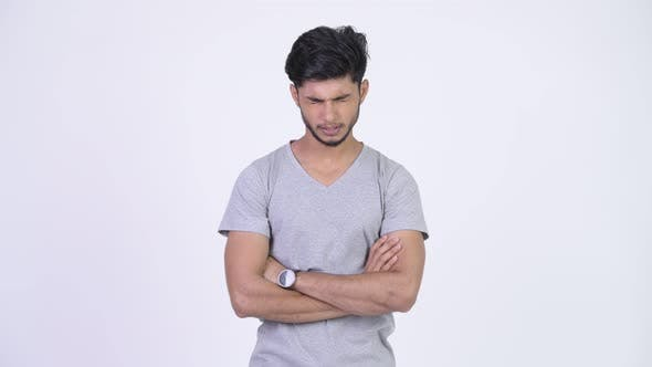Thumbnail for Young Angry Bearded Indian Man with Arms Crossed