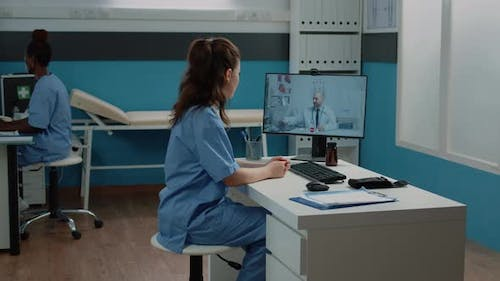 Nurse Talking to Doctor on Video Call for Professional Advice