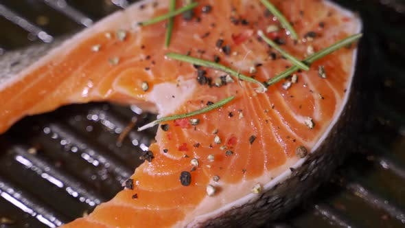 Thumbnail for Grilling Salmon Fillet on Smoking Grill Outdoor. Close Up Salmon Fillet Barbecuing on Charcoal Grill
