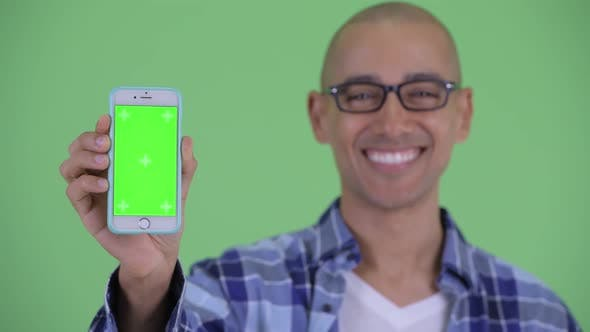 Cover Image for Face of Happy Bald Hipster Man Showing Phone
