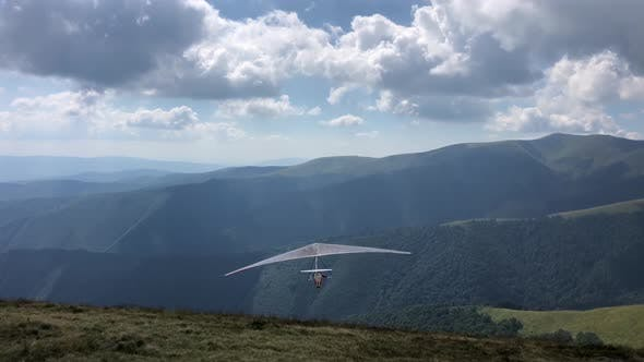 Hang glider in the air. Aerial footage of extreme sports
