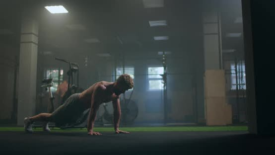 Thumbnail for a Strong Purposeful Man Performs push-UPS Despite Fatigue and Pain Overcoming Difficulties. the