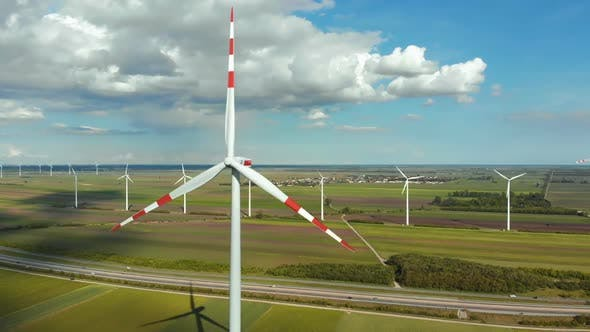 Cover Image for Aerial View of Wind Turbines Farm in Field. Austria. Drone View on Energy Production
