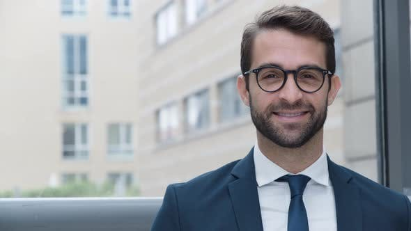 Thumbnail for Businessman Adjusting Glasses Before Smiling