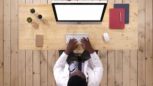 Medical Worker Typing on the Computer