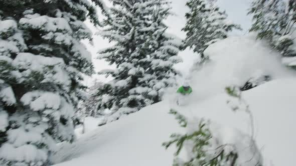 Thumbnail for Snowboard Drop Off Pillow Cliff Riding Through Deep Snow And Trees Green Jacket