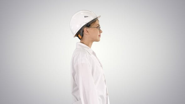 Thumbnail for Scientist Physicist Woman Walking in Lab Coat and Hardhat