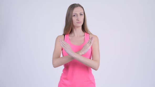 Thumbnail for Portrait of Serious Blonde Woman Showing Stop Gesture Using Arms