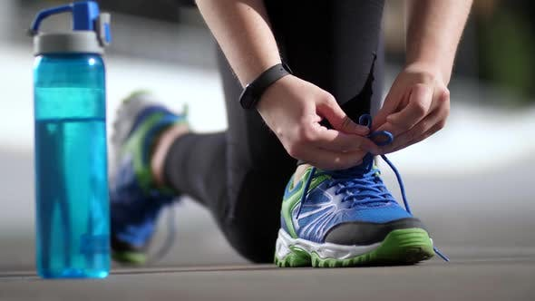 Thumbnail for Hands of Plus Size Woman Runner Tying Shoelaces