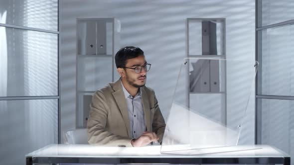 Cover Image for Arab Businessman Working on Futuristic Transparent Computer in Office