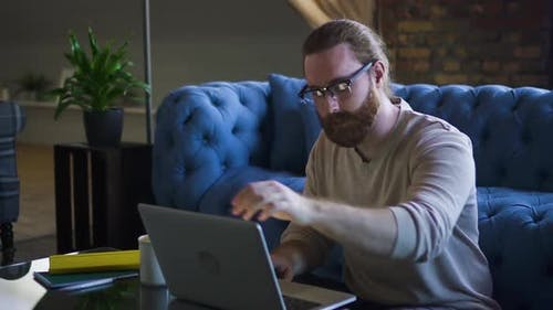 Man Freelancer Opening Laptop and Starting Typing Spbd. Bearded Hipster Businessman Working Remote