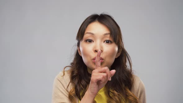 Cover Image for Asian Woman Making Shush Gesture
