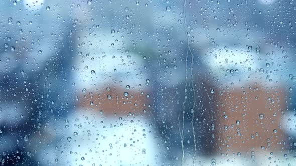 Thumbnail for Rain Drops Pouring Down On Glass Window on Cold Raining Day